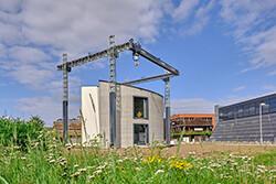 Weltweit erstes einteiliges3D-Betonhaus mit Natur-Klimadecken ausgestattet